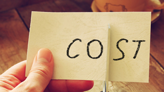 hand holding a piece of paper that says cost