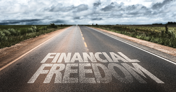 A roadway with text, text reads financial freedom